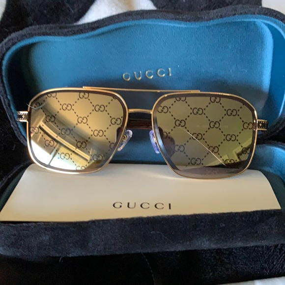Gucci monogram lenses sunglasses gold metal frame